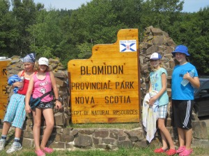 Josie, Georgia, Emily and Abigail in front of the Park sign.