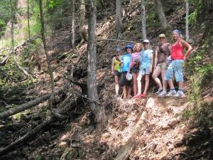 "Sarah, Abigail, Georgia, Emily, Crystal and Josie beside the ""waterfall"""