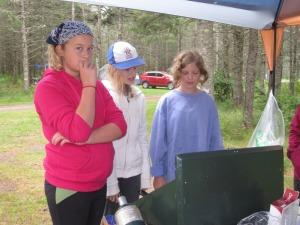 Josie, Emily and Georgia cooking breakfast
