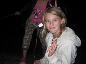 Emily enjoying a fire roasted marshmallow