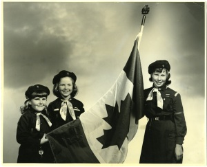 B.C. Browines fly a Canadian flag in 1967. This photo appeared on our 2010 100th anniversary cookie box. (APH 100)