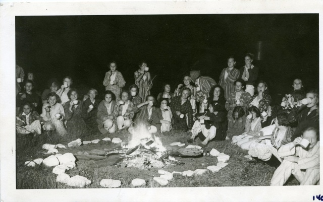 Sitting around the campfire, from Early Canadian Guiding Album, pre-1940